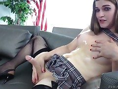 Seductive shemale Tiffany Starr slowly strokes the brush dick while dressed in a short skirt and