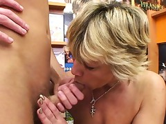 Sexy light-haired mature penetrates him in the vid store